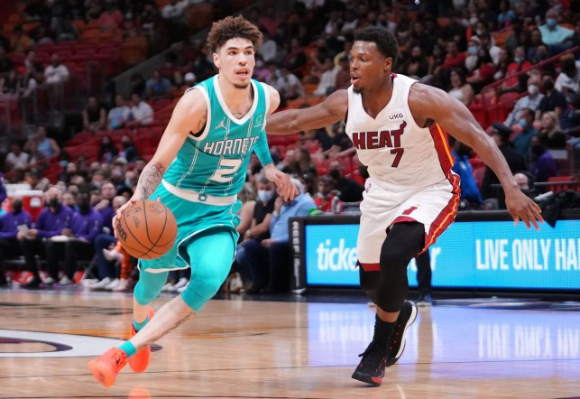 Charlotte Hornets' La Melo Ball under the protection of Kyle Lowry (# 7) of the Miami Heat