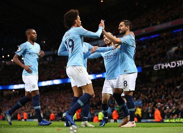 Sane, Silva and goalscorer Gundogan all celebrate during City's 3-1 home win