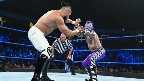 Andrade (left) during his match against Rey Mysterio (right)
