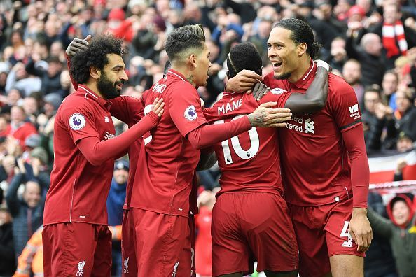 Liverpool players celebrate one of their goals in a must-win game against Chelsea on Sunday afternoon