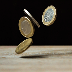 Photo of a coin toss to represent binary data.