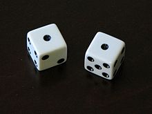 Photograph of dice showing snake eyes.