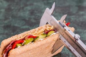 Photograph of measuring a sandwich