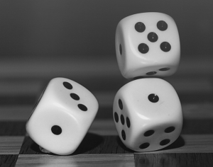 photogram of tumbling dice to illustrate a process for random assignment.