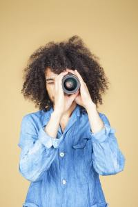 Photograph of a person observing to illustrate an observational study.