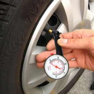 Photo of tire pressure gauge.
