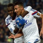 Lyon's French midfielder Corentin Tolisso (R) is congratuled by Lyon's Guinean forward Mohamed Yattara (L) after scoring a goal during the French L1 football match between Montpellier and Lyon on March 8, 2015 at the La Mosson Stadium in Montpellier, southern France. AFP PHOTO / PASCAL GUYOT