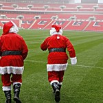 Wnsl Pr Shoot - Wembley National Stadium Limited PR Shoot 20/12/2006 - Wembley Stadium - 20/12/06 ;Groundsmen dressed as Santa walk on the grass