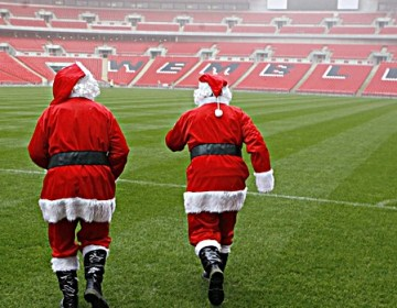 Wnsl Pr Shoot - Wembley National Stadium Limited PR Shoot 20/12/2006 - Wembley Stadium - 20/12/06 ;Groundsmen dressed as Santa walk on the grass