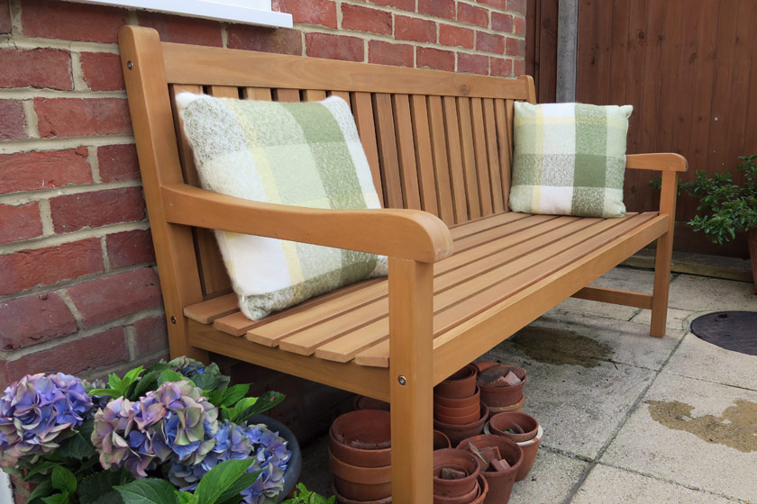 Wooden bench and cushions