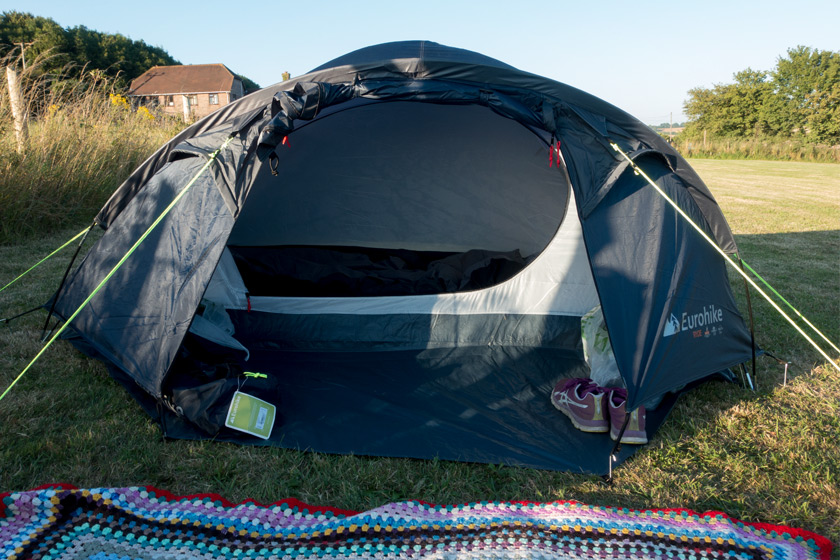 Pitched tent in field