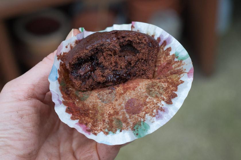 Cupcake in muddy hands