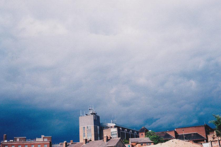 Dark moody skies over city