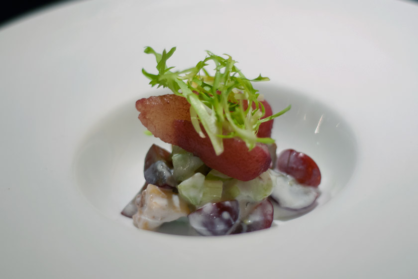 Poached pear on top of grapes and celery