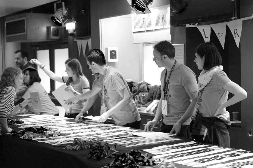 Volunteers with rows of lanyards
