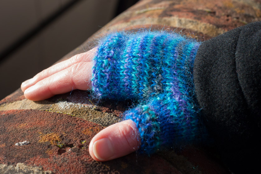 Blue knitted fingerless glove