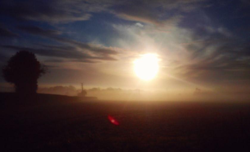 Sunrise over countryside