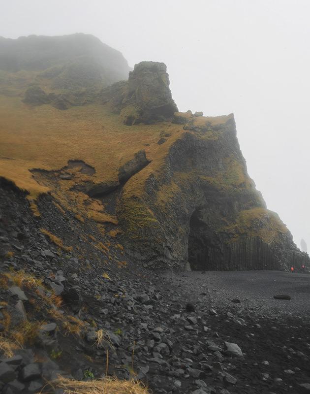Cave on black sand beach