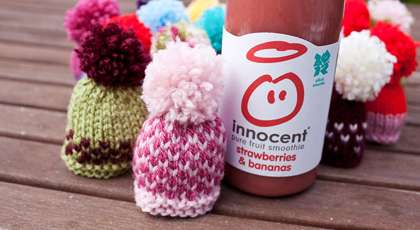 Collection of knitted hats with smoothie bottle