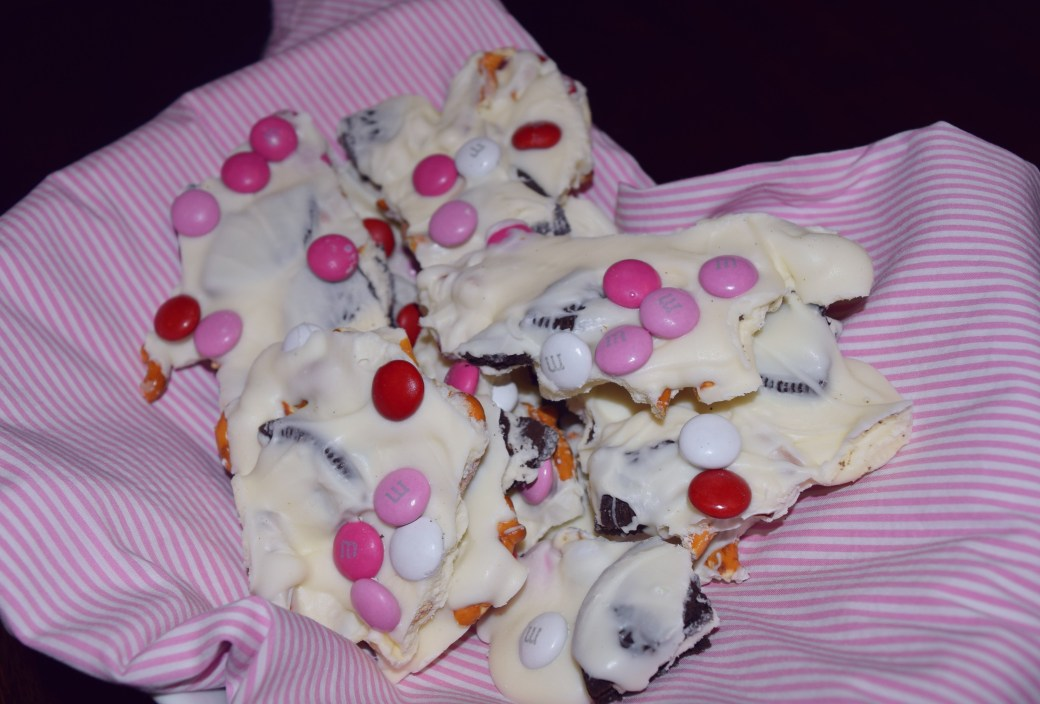 Valentine's Day Candy Bark is a great Valentines Day dessert. Sweet & salty and so quick and easy to make! It is the perfect Valentine's Day party food or for a quick and easy family night treat! Repin now for later!