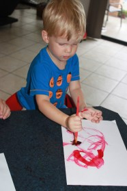 Mr 2 doesn't quite have the fine motor skills required to keep the paper out of the liquid, so I let him play with a paint brush and the mixture to keep him happy.