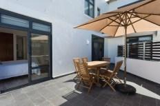 Big Bay Accommodation patio table balcony