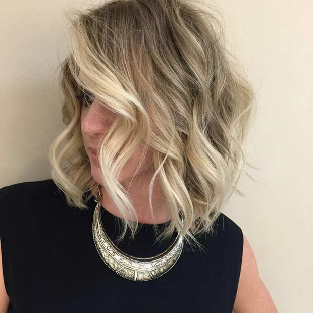 Textured Bob Haircut with Blonde Face Framing Highlights