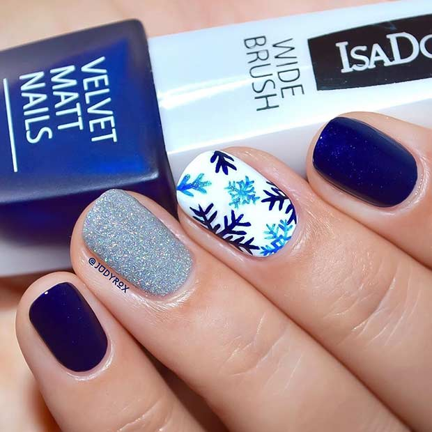 Navy Blue Snowflake Winter Nail Design