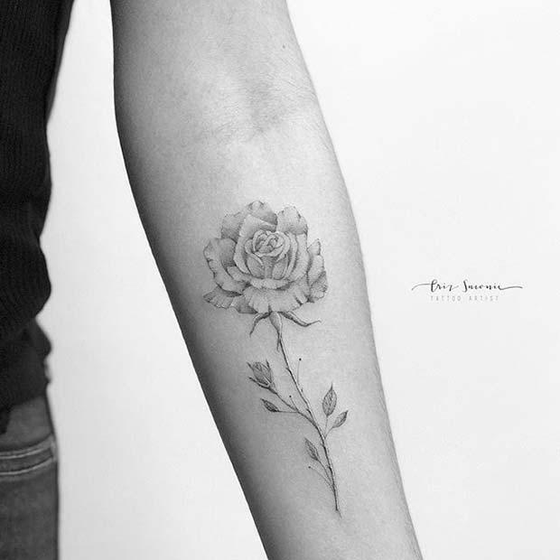 Delicate Single Rose Arm Tattoo Idea