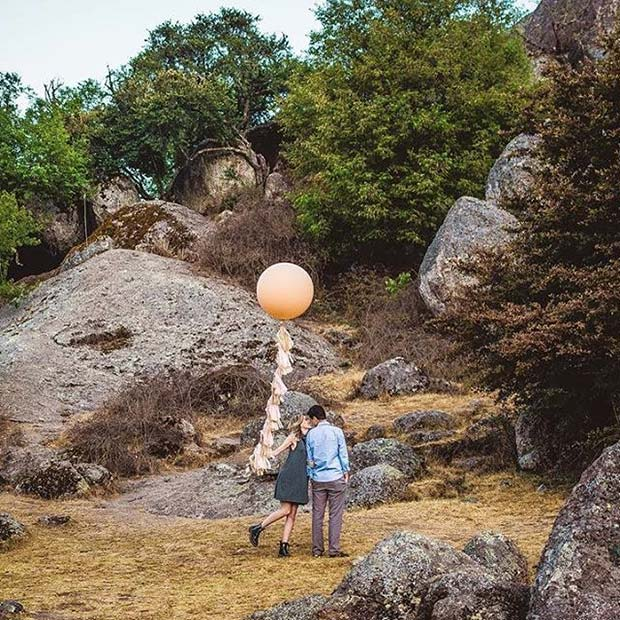 Cute Couple's Photo with Balloon for Romantic Engagement Photo Idea