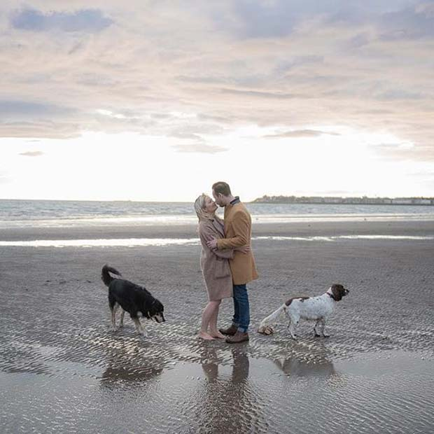 Cute Couple with Dogs on the Beach for Romantic Engagement Photo Idea