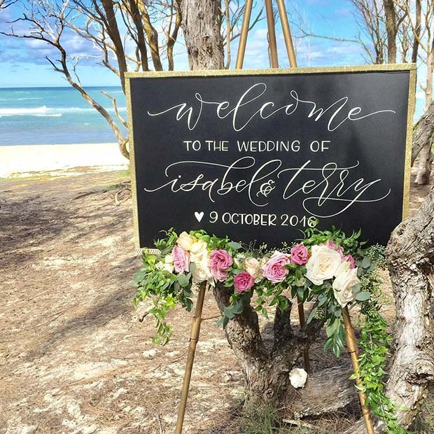 Outdoor Wedding Sign Idea with Fresh Flowers