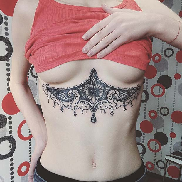 10. Ornamental Jewelry Sternum Tattoo Idea