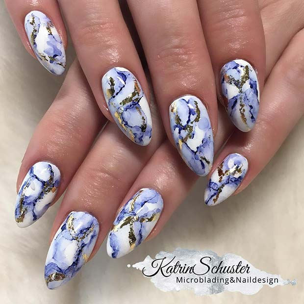 Elegant Blue and Gold Marble Nails