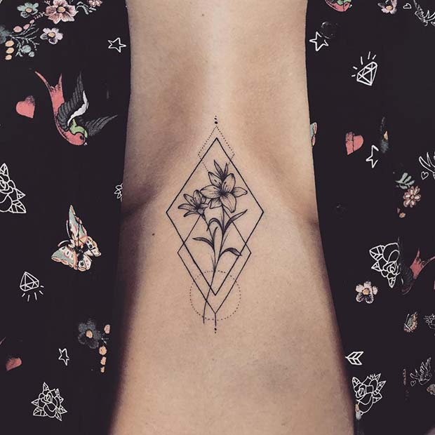 Lily Sternum Tattoo with Geometric Design