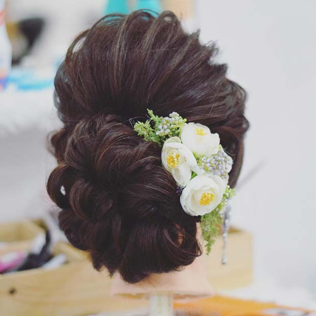 Elegant Low Bun with Floral Accessory