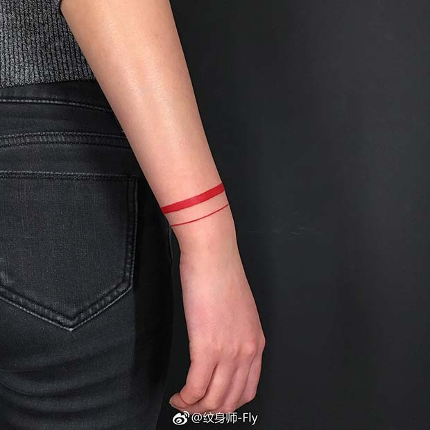 Red Ink Wrist Tattoo