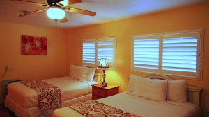 Our Deluxe Double Rooms feature two comfortable double beds, clean bathroom with a shower or tub, kitchenette w/ microwave, coffee maker, refrigerator and stove top in most rooms; Flat Screen Cable TV; Free Wi-Fi and dining area.