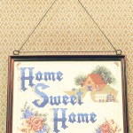 home sweet home needlepoint hanging on wall