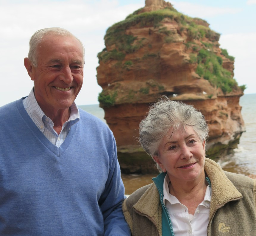 Strictly Come Dancing judge Len Goodman with Valerie Singleton on the beach at Ladram Bay