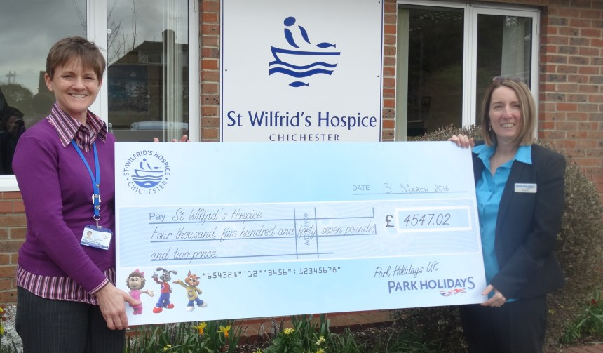 Holiday park's cheque-in time: St Wilfrid's Hospice charity co-ordinator Alisa Lakeman-Ford (left) receives the fundraising cheque from park administration manager Sharon Dawes