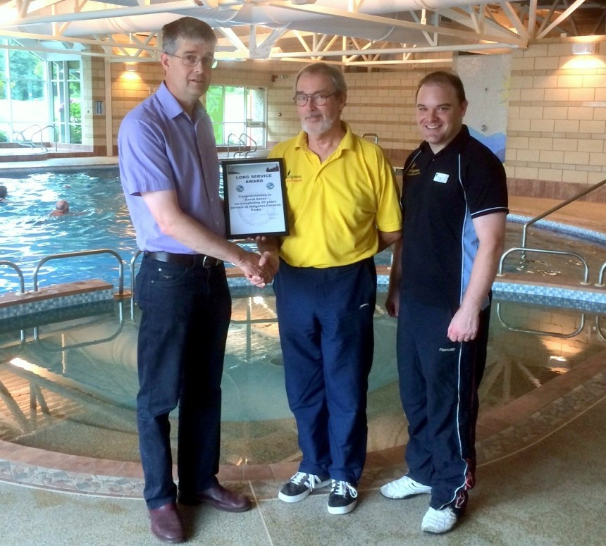 Michael Holgate (left) presents a long service award to retiring gym club manager David Oates. On the right is incoming manager Paul Tracey