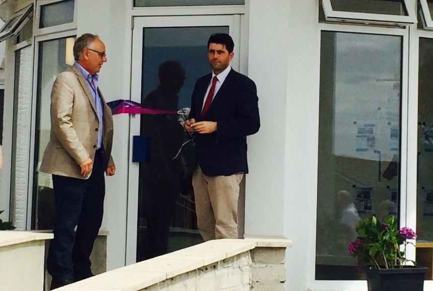 Scott Mann MP (right) gets ready to cut the tape on St Merryn's new reception building in the company of park co-owner Leigh Ibbotson