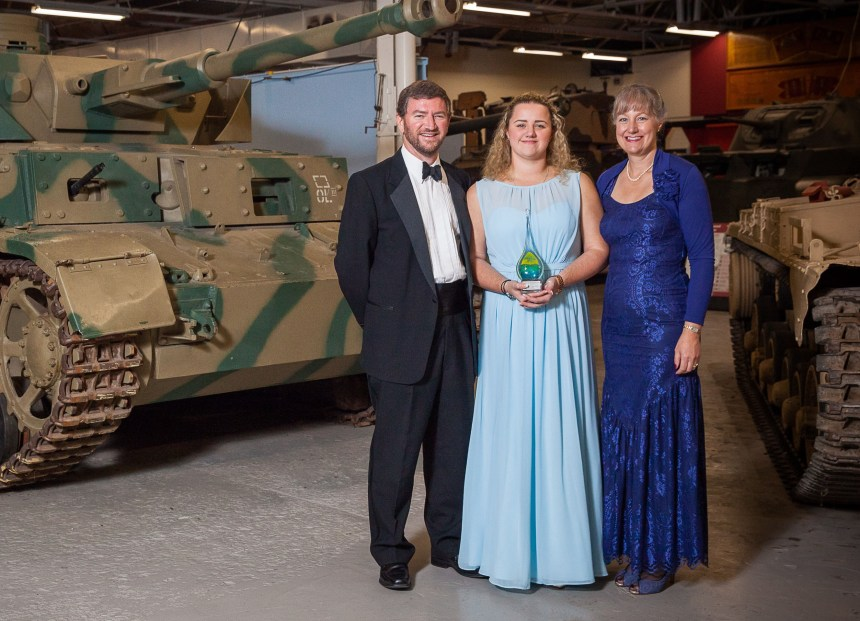 Tony and Sarah Birch with (centre) their daughter Chrissy receive their award at the Bovington Tank Museum