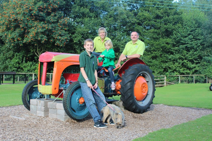 Riding high: Poston Mill park owners Sarah and Wayne Jones with their two children, Lewis and Connie