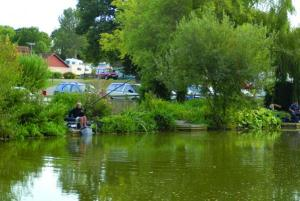 A picturesque fishing lake on the park is much admired by visitorsthe park is much admired by visitors