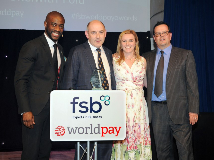 Henry and Hannah Wild (centre) with (left) awards host and entrepreneur Tim Campbell MBE who was hired by Lord Alan Sugar in the first series of The Apprentice, and James Frost, chief marketing officer of Worldpay UK