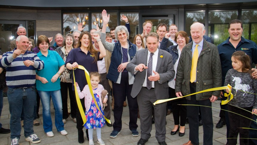 It's a snip: Neil Parish MP is joined by Oakdown's owners, staff and friends for the official tape cutting
