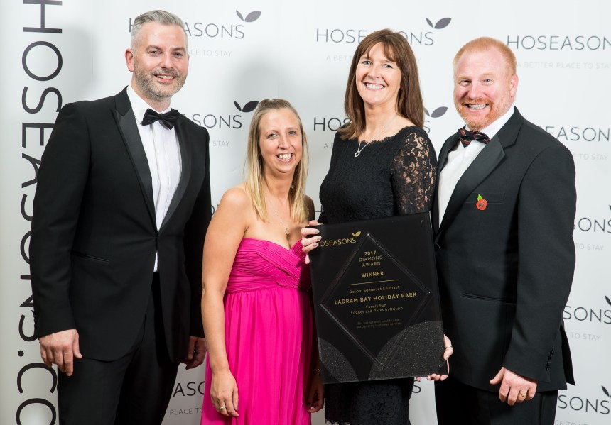 Winning smiles at the awards finals:(from left): Scott Drew from Hoseasons congratulates Ladram Bay's holiday sales manager Lisa Spickett, director Zoe House, and general manager Steven Harper-Smith
