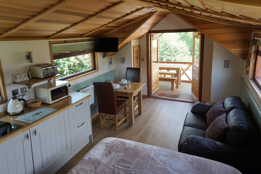 Luxurious interior of one of a glamping pod at Old Oaks which attracts visitors from across the UK and overseas